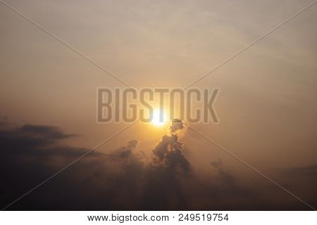 Orange sun on cloudy sky, morning sky landscape photo. Hot day morning with dusty sky. Orange sunrise. Morning dew in Cambodia. Orange skyscape with morning sun. Tropical weather in rain season banner stock photo