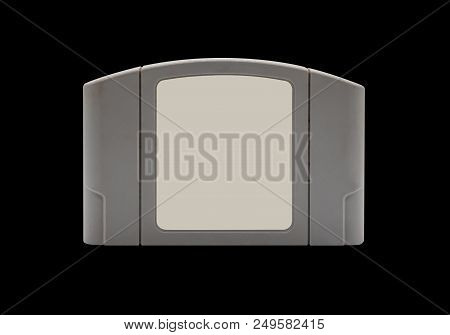 TV game cartridge in grey plastic case from 90s isolated on white background stock photo
