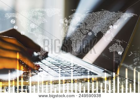 work process nowadays with double exposure of hand typing on laptop and digital world map an financial chart illustration stock photo