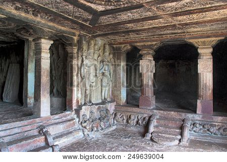 Interior view of Ravanaphadi rock-cut temple, Aihole, Bagalkot, Karnataka, India. Exquisitely carved ceiling of the matapa, carved Shiva figures is clearly seen. stock photo