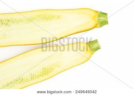 Group of two halves of raw yellow zucchini flatlay isolated on white stock photo