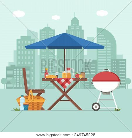 Summer picnic table on city background. Family barbecue concept with picnic party stuff. Bbq grill, straw basket and food for outing on public park. stock photo