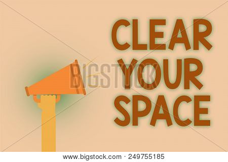 Word writing text Clear Your Space. Business concept for Clean office studio area Make it empty Refresh Reorganize Hand brown loud speaker sound public message hot issue announcement stock photo