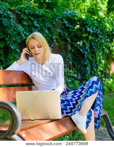 Remote jobs browse top freelance remote work opportunities. Lady freelancer working in park. Woman with laptop works outdoor green nature background. Girl sit bench with notebook looking new job. stock photo