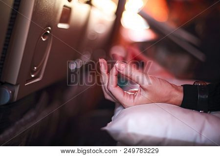 Person in airplane with aerophobia scared of flying being afraid while sitting in airplane seat and doing yoga for relax stock photo