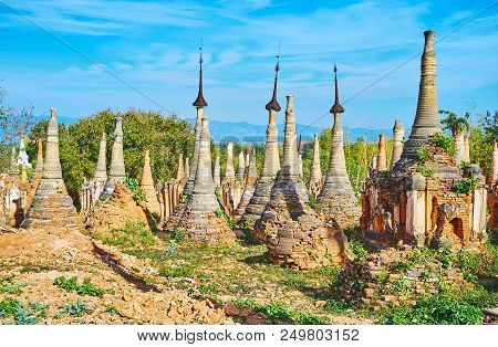 The ancient ruins of Buddhist stupas of Nyaung Ohak attract tourists to visit Inn Thein villageon Inle Lake, Myanmar. stock photo