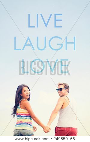LIVE LAUGH LOVE inspirational message written on background for social media design poster sign. Young couple in love enjoying life by living, laughing, loving. Inspiration quote. stock photo