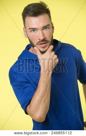 Beard concept. Handsome man touch beard with hand. Bearded man with beard on unshaven face. Beard grooming. Getting perfect shape. stock photo