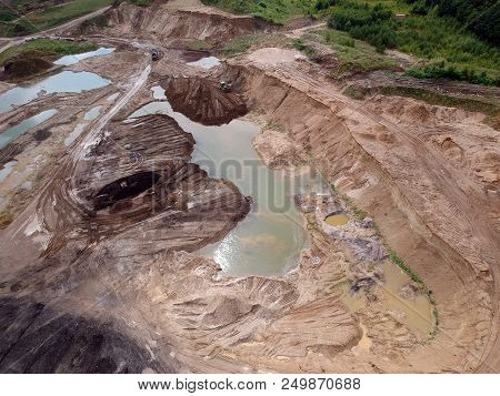 Aerial view on open pit mine of sand and hummus, flooded with water. stock photo