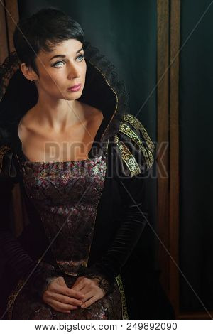 Attractive girl in retro baroque style dress. Old fashion style. stock photo