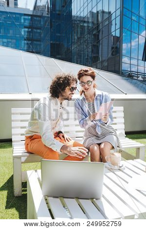 Interior designers. Two creative interior designers having many interesting ideas while working on new project stock photo