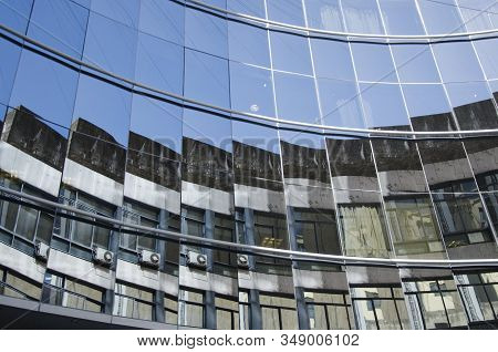 Glazed building that generates strange reflections of the surrounding buildings, in the downtown area of Buenos Aires, Federal Capital stock photo