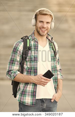 Educational technology use physical hardware software and educational theoretic. College education. College life. College student headphones smartphone. Listen music. Audio book. Modern and digital. stock photo