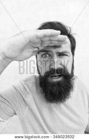 look. Man bearded hipster stylish beard grey background. Perceptions of male beauty. Stylish beard and mustache care. Strict face. Beard fashion barber. Handsome guy. Masculinity concept. stock photo