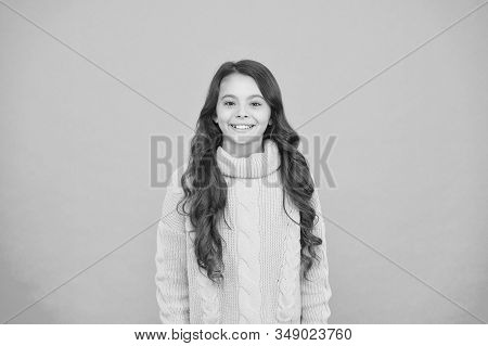 Positivity concept. Good vibes. Emotional baby. Positive child. Positive attitude to life. Inspiration. Positive mood. Kids psychology. Adorable smiling girl wear yellow sweater turquoise background. stock photo
