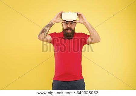 Virtual communication concept. Virtual simulation. Virtual reality is like dreaming with your eyes open. Impressive experience. Man play game in VR glasses. Hipster with virtual reality headset. stock photo