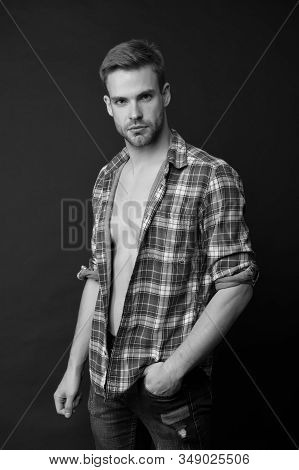Forever casual. Handsome man in casual wear. Styling casual wear for men. Casual fashion style. Fashion and style. Sexy guy on dark background. Feeling comfortable and confident. stock photo