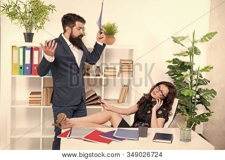 Competing for her attention with phone. Woman boss having phone call while colleague try to talk. Busy lady. Phone negotiations. Mobile addicted. Important conversation. Communication problem. stock photo