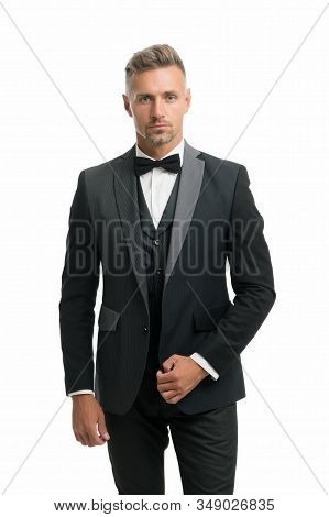 Suit for special occasion. Elegant accessory. Tailored suit. Fashion shop. Rent suit service. Elegant fashion outfit. Gentleman modern style. Well groomed handsome man wear tuxedo. Fashion clothes. stock photo