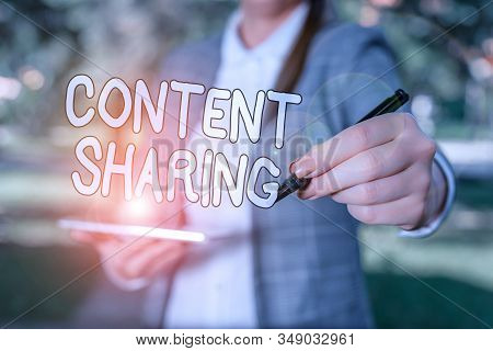 Conceptual hand writing showing Content Sharing. Business photo showcasing distribution of webpage and blog content across social media Outdoor background business woman holding laptop and pen. stock photo