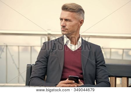 Waiting for message. Modern life demands modern gadgets. Man with smartphone. Mobile phone always with me. Hipster well groomed man use smartphone. Internet surfing social networks with smartphone. stock photo