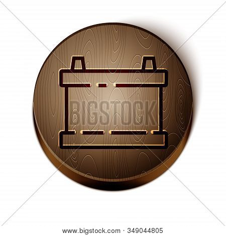 Brown line Car battery icon isolated on white background. Accumulator battery energy power and electricity accumulator battery. Wooden circle button. Vector Illustration stock photo