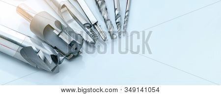 Special tools isolated on white background. Made to order special tools. Coated step drill and reamer detail. HSS cemented carbide. Carbide cutting tool for industrial applications. Engineering tools. stock photo