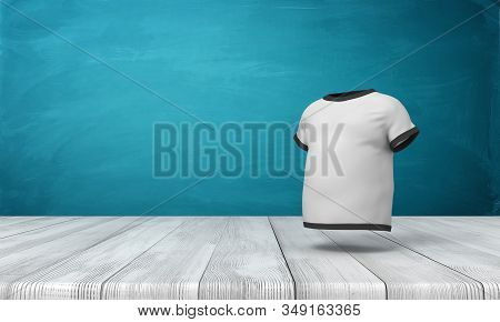 3d rendering of white mens T-shirt with black edge piping, suspended in air above wooden floor, near blue wall. stock photo