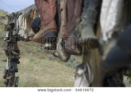 A display of well used cowboy boots, put away to there final resting place