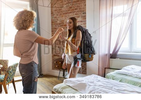 Young female backpacker renting apartment  stock photo