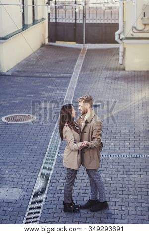 young happy couple hugging in the city on Valentine's day stock photo