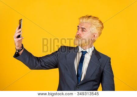 Application online services. Man with smartphone. Modern communication. Mobile communication. Communicative skills. Business communication. Call his lawyer. Real estate agent. Serious conversation stock photo