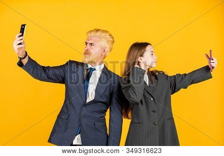 Media content. Communicative skills. Business communication. Social networks. Modern communication. Mobile communication. Application online services. Internet surfing. Man and girl with smartphones stock photo