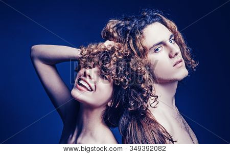Family couple man and girl. Studio shot of couple fooling around in valentines day. Young beautiful couple in love. Glad girl having fun with boyfriend. Smile joyfully have good relationships stock photo