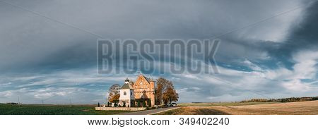 Synkavichy, Zelva District, Hrodna Province, Belarus. Old Church Of St. Michael The Archangel. Orthodox Church. Belarusian Gothic Fortified Church. Famous Historic Landmark And Heritage. Panorama. stock photo