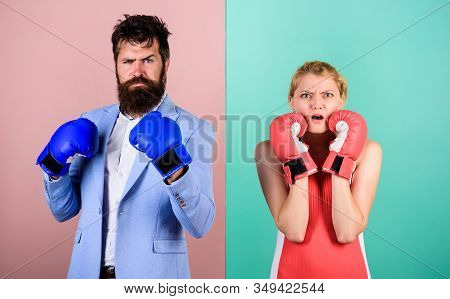 Conflict concept. Man and woman boxing fight. Family life. Complicated relationships. Couple romantic relationships. Boxers fighting gloves. Difficult relationships. Couple in love competing boxing stock photo