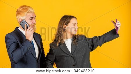 Media content. Communicative skills. Business communication. Social networks. Application online services. Internet surfing. Man and girl with smartphones. Modern communication. Mobile communication stock photo