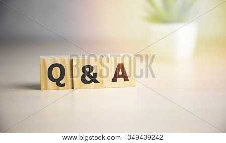 Q A or Questions and answers on black block with sunshine background. stock photo