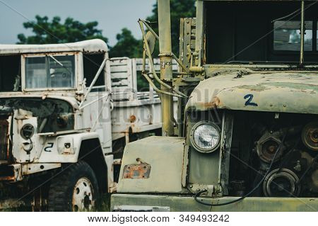 Old wrecked white and green truck. Abandoned rusty military truck. Decayed abandoned truck. Tragedy and loss. Financial crunch and economic recession concept. Old decayed lorries. Transportation. stock photo