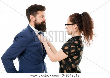woman fix her man bowtie. formal business couple. business with personal assistant. elegant sexy woman fixing her lovers bowtie. Preparation for party. corporate party in office. mr perfection. stock photo