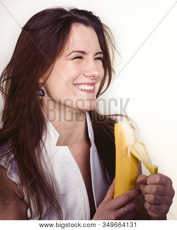 young pretty girl eating banana, lifestyle people concept stock photo