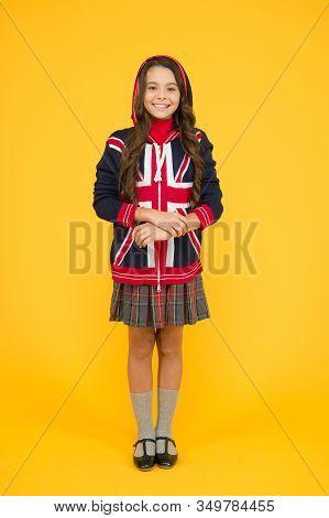 Learn english language. Language school. English kid yellow background. British accent. Great Britain flag. International exchange. Girl school uniform. English student. Education and upbringing. stock photo