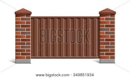Fence with brick pillars and metal profile. stock photo