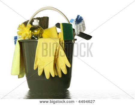 Wet plastic bucket with cleaning supplies isolated on white background stock photo