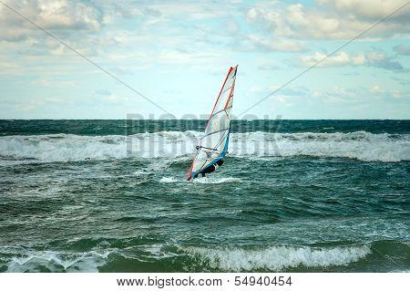 Sea windsurfing sport sailing water active leisure windsurfer training on waves summer day