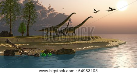 Mamenchisaurus dinosaurs walk to a lake for a morning drink as Microraptors fly overhead. stock photo