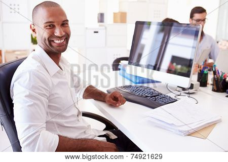 Businessman At Computer In Office Of Start Up Business stock photo