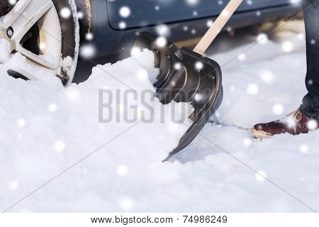transportation, winter, people and vehicle concept - closeup of man digging snow with shovel near car stock photo