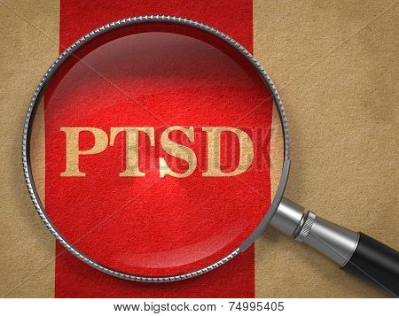 PTSD through Magnifying Glass on Old Paper with Red Vertical Line. stock photo