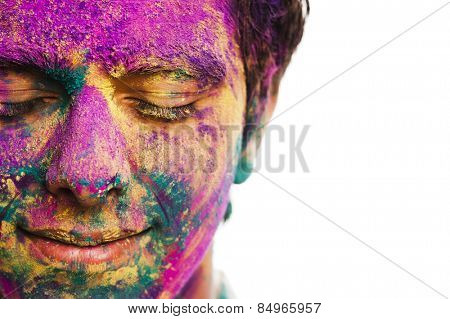 Man's face covered with powder paint during Holi festival stock photo